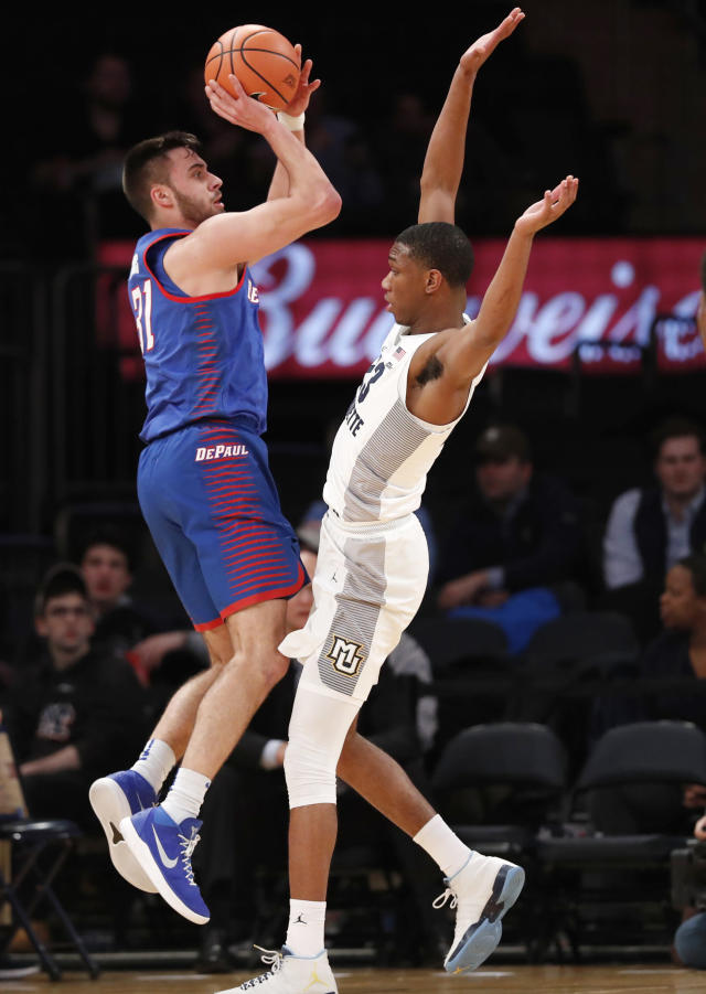 DePaul guard Max Strus (31) shoots from the three-point line as Marquette forward Jamal Cain (23) backs off during the first half of an NCAA college basketball game in the first round of the Big East conference tournament, in New York, Wednesday, March, 7, 2018. (AP Photo/Kathy Willens)
