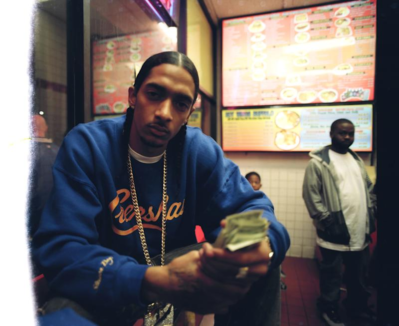 """An outtake of Nipsey from his """"Hussle In The House"""" music video shoot at Master Burger, 2009."""