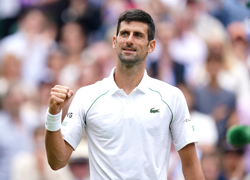 Novak Djokovic celebrates winning against Marton Fucsovics in the quarter-final men's single match on centre court on day nine of Wimbledon at The All England Lawn Tennis and Croquet Club, Wimbledon. Picture date: Wednesday July 7, 2021. (Photo by Adam Davy/PA Images via Getty Images)
