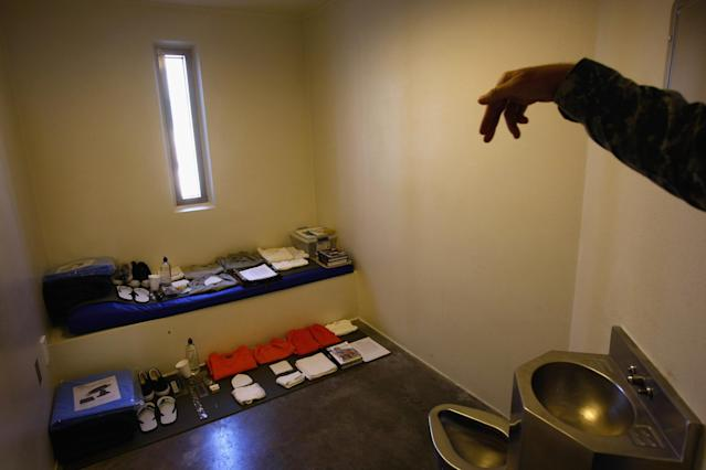 GUANTANAMO BAY, CUBA - OCTOBER 27: A military guard shows a display cell in the maximum security section of the U.S. military prison for 'enemy combatants' on October 27, 2009 in Guantanamo Bay, Cuba. Although U.S. President Barack Obama pledged in his first executive order last January to close the infamous prison within a year's time, the government has been struggling to try the accused terrorists and to transfer them out ahead of the deadline. Military officials at the prison point to improved living standards and state of the art medical treatment available to detainees, but the facility's international reputation remains tied to the 'enhanced interrogation techniques' such as waterboarding employed under the Bush administration. (Photo by John Moore/Getty Images)
