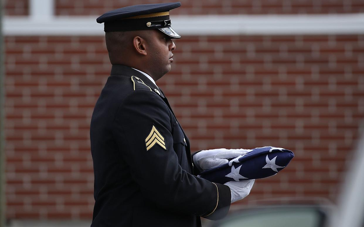 An American flag is carried into the funeral for Alaina Petty on February 19, 2018 in Coral Springs, Florida. (Photo: Joe Raedle via Getty Images)