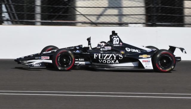 Ed Carpenter pumps his fist after he qualified on the pole for the IndyCar Indianapolis 500 auto race at Indianapolis Motor Speedway in Indianapolis, Sunday, May 20, 2018. (AP Photo/John Maxwell)