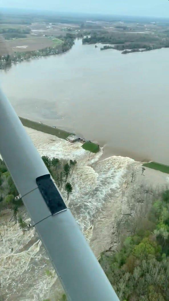 Aerial view of water from a broken Edenville Dam seen flooding the area as it flows toward Wixom Lake, in Michigan, in this still frame obtained from social-media video dated May 19, 2020.