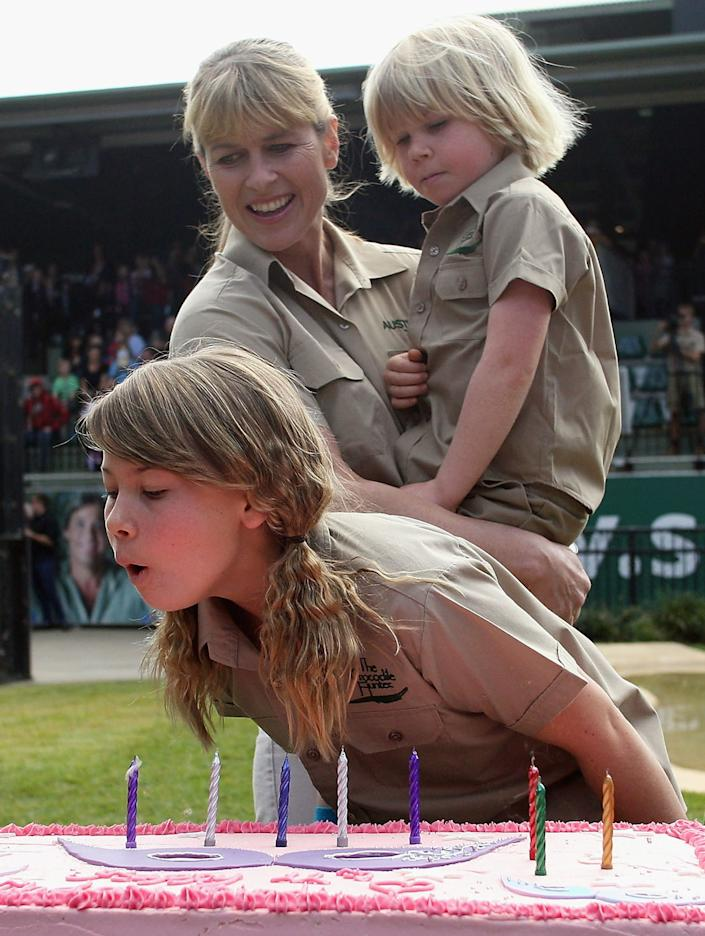 TV personality Bindi Irwin blows out the candles on her birthday cake as she celebrates her 11th birthday with her mother Terri Irwin and brother Robert (Bob) Irwin at Australia Zoo on July 24, 2009 in Beerwah on the Sunshine Coast near Brisbane, Australia. (Photo by Bradley Kanaris/Getty Images)