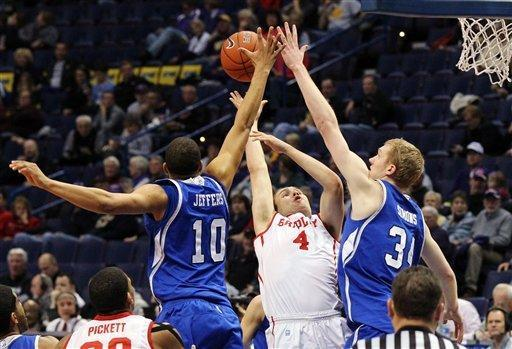 Drake forwards Jeremy Jeffers (10) and Ben Simons (34) team up to block a shot by Bradley's Jake Eastman during the first half of their NCAA college basketball game in the Missouri Valley Conference tournament, Thursday, March 7, 2013, in St. Louis, Mo. (AP Photo/St. Louis Post-Dispatch, Chris Lee)