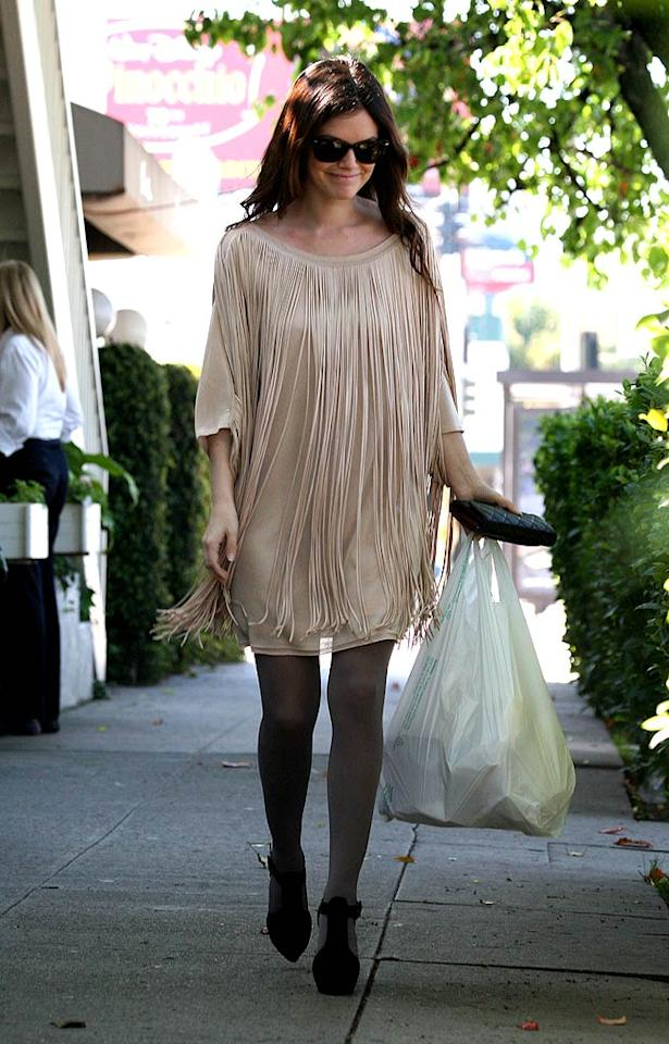 """Rachel Bilson hid her fit and fab frame under a foul Phillip Lim creation while shopping in SoCal. What's worse? The fringed flop, or her gray tights and clunky Christian Louboutin booties? IONU/<a href=""""http://www.x17online.com"""" target=""""new"""">X17 Online</a> - March 7, 2009"""