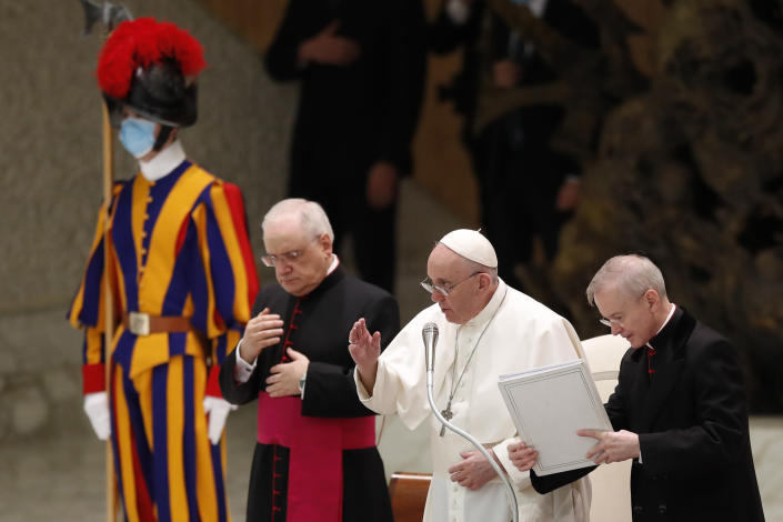 "Pope Francis delivers his blessing in the Paul VI Hall at the Vatican at the end of his weekly general audience, Wednesday, Oct. 28, 2020. A Vatican official who is a key member of Francis' COVID-19 response commission, the Rev. Augusto Zampini, acknowledged Tuesday that at age 83 and with part of his lung removed after an illness in his youth, Francis would be at high risk for complications if he were to become infected. Zampini said he hoped Francis would don a mask at least when he greeted people during the general audience. ""We are working on that,"" he said. (AP Photo/Alessandra Tarantino)"