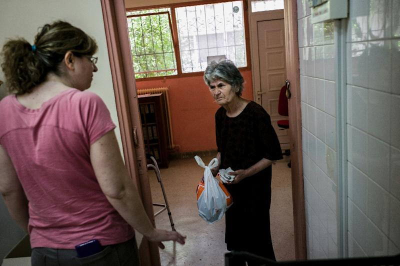 Joblessness is an existential concern for many in Perama, an Athens suburb -- and as the population has become poorer a social grocery store and soup kitchen has been set up (AFP Photo/Angelos TZORTZINIS)