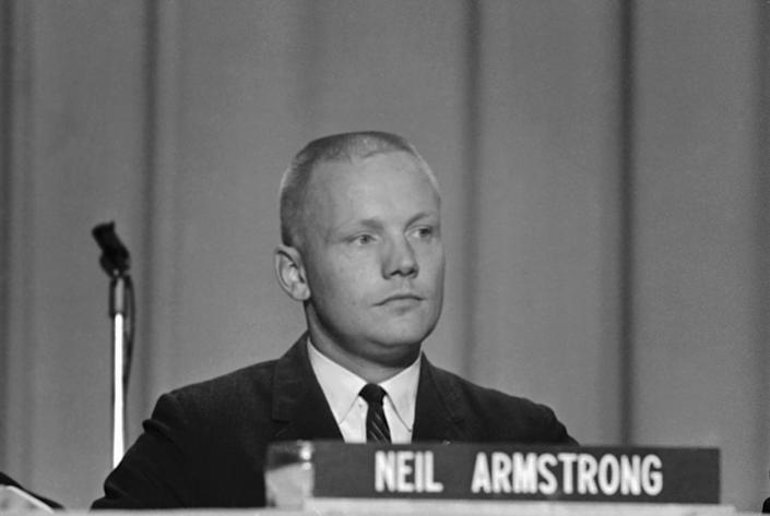 """FILE - In this Sept. 17, 1962 file photo, Neil Armstrong, one of the nine astronauts, is shown as he was introduced to the press, along with the other astronauts in Houston. The family of Neil Armstrong, the first man to walk on the moon, says he died Saturday, Aug. 25, 2012, at age 82. A statement from the family says he died following complications resulting from cardiovascular procedures. It doesn't say where he died. Armstrong commanded the Apollo 11 spacecraft that landed on the moon July 20, 1969. He radioed back to Earth the historic news of """"one giant leap for mankind."""" Armstrong and fellow astronaut Edwin """"Buzz"""" Aldrin spent nearly three hours walking on the moon, collecting samples, conducting experiments and taking photographs. In all, 12 Americans walked on the moon from 1969 to 1972. (AP Photo/File)"""