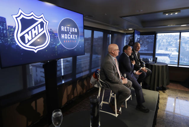 NHL Commissioner Gary Bettman, center, joins Deputy Commissioner Bill Daly, left, and Tod Leiweke, right, president and CEO of the Seattle Hockey Partners group, Wednesday, Jan. 9, 2019, during a news conference in Seattle. Bettman said Wednesday the NHL has promised Seattle it will host the hockey All-Star Game within its first seven seasons. (AP Photo/Ted S. Warren)