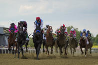 John Velazquez atop Medina Spirit, center left, leads the pack out of the gates during the 146th Preakness Stakes horse race at Pimlico Race Course, Saturday, May 15, 2021, in Baltimore. (AP Photo/Julio Cortez)