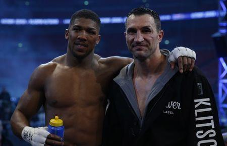 Britain Boxing - Anthony Joshua v Wladimir Klitschko IBF, IBO & WBA Super World Heavyweight Title's - Wembley Stadium, London, England - 29/4/17 Anthony Joshua with Wladimir Klitschko after the fight Action Images via Reuters / Andrew Couldridge Livepic