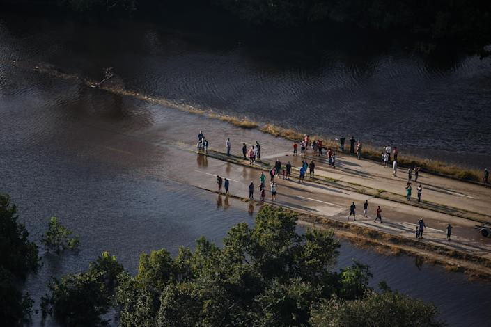 <p>People come out to visit the flooded areas near their homes on August 29, 2017 in Houston, Texas. (Photo: Marcus Yam / Los Angeles Times via Getty Images) </p>