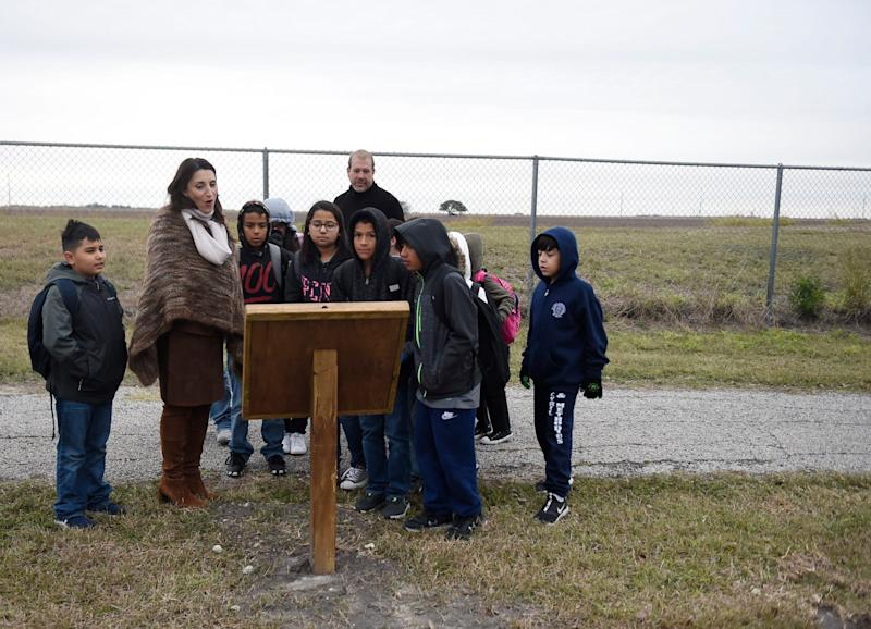 "Nueces Judge Barbara Canales walks with children Wednesday through the StoryWalk at Oscar O. Ortiz Park in Robstown, Texas. Canales read the story ""We're Going on a Bear Hunt"" by Michael Rosen while walking with kids."