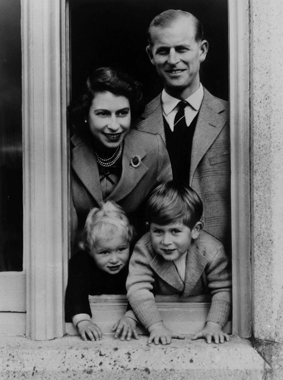 <p>In September 1952, Prince Philip and Queen Elizabeth posed with their young children, Charles and Anne, at Balmoral Castle in Scotland.</p>