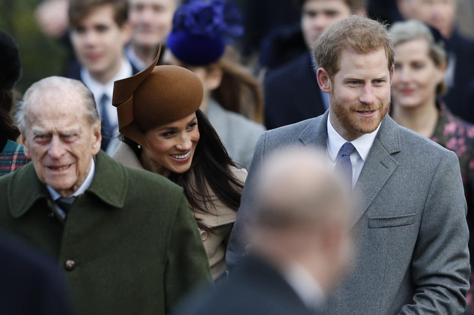 (L-R) Britain's Prince Philip, Duke of Edinburgh, US actress and fiancee of Britain's Prince Harry Meghan Markle and Britain's Prince Harry (R) arrive to attend the Royal Family's traditional Christmas Day church service at St Mary Magdalene Church in Sandringham, Norfolk, eastern England, on December 25, 2017. / AFP PHOTO / Adrian DENNIS        (Photo credit should read ADRIAN DENNIS/AFP via Getty Images)