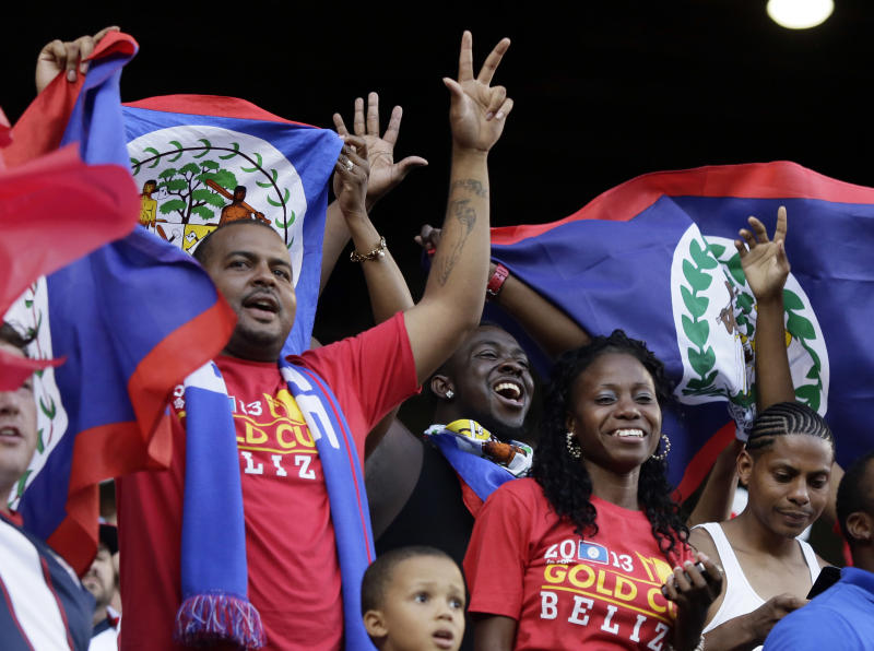 Belize fans cheer during the first half of their CONCACAF Gold Cup soccer game against the United States in Portland, Oregon Tuesday, July 9, 2013.(AP Photo/Don Ryan)