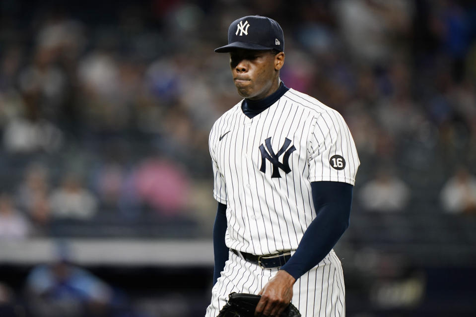 New York Yankees relief pitcher Aroldis Chapman (54) reacts leaving the mound after pitching in the top of the ninth inning after blowing an opportunity to earn a save in a baseball game against the Kansas City Royals, Wednesday, June 23, 2021, at Yankee Stadium in New York. Chapman was awarded the win when Yankees Luke Voit hit a game-winning, RBI single in the bottom of the ninth inning. (AP Photo/Kathy Willens)