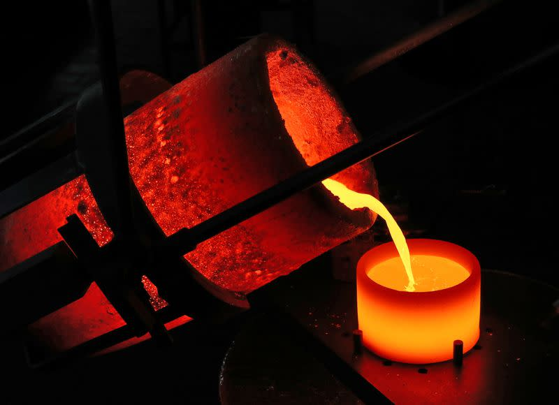 Liquid gold is poured to form grains at Swiss refinery Metalor in Marin