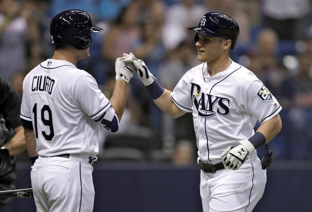 Tampa Bay Rays' Jake Bauers, right, high fives on-deck batter Nicholas Ciuffo after Bauers hit a two-run home run off Cleveland Indians pitcher Corey Kluber during the second inning of a baseball game Monday, Sept. 10, 2018, in St. Petersburg, Fla. (AP Photo/Chris O'Meara)