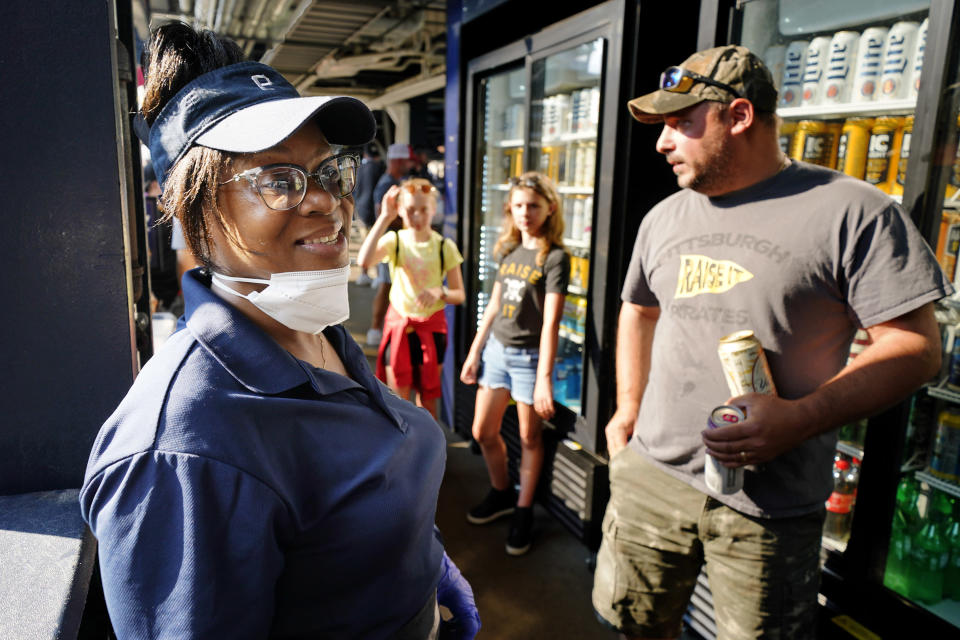 Andrienna Alford, left, a vendor at Pittsburgh sports venues for 33 years, works at a serve yourself beer stand in the concourse at PNC Park during a baseball game between the Pittsburgh Pirates and the Atlanta Braves in Pittsburgh, Monday, July 5, 2021. (AP Photo/Gene J. Puskar)