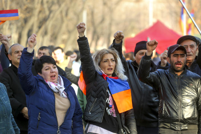 Opposition demonstrators shout anti-government slogans as they rally to pressure Armenian Prime Minister Nikol Pashinyan to resign in Yerevan, Armenia, Wednesday, March 3, 2021. Thousands of opposition supporters are rallying in the Armenian capital to demand the resignation of the country's prime minister amid a heavy presence of security forces. Prime Minister Nikol Pashinyan has faced the opposition demands to step down since he signed a peace deal that ended six weeks of fighting over the Nagorno-Karabakh region, in which Azerbaijan routed the Armenian forces. (Hrant Khachatryan/PAN Photo via AP)