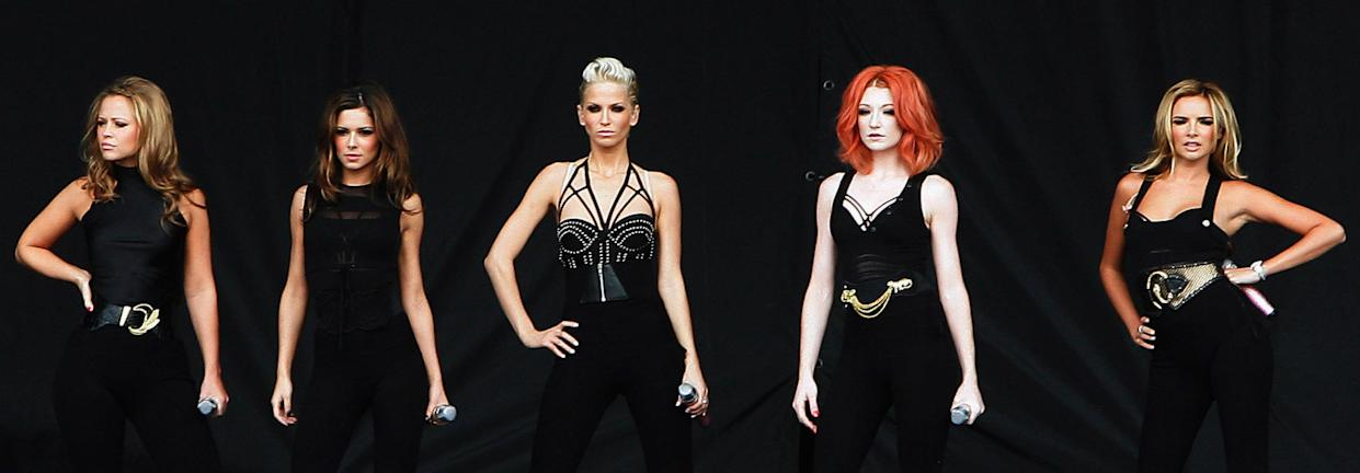 CHELMSFORD, UNITED KINGDOM - AUGUST 17:  (L to R) Kimberley Walsh, Cheryl Cole, Sarah Harding, Nicola Roberts and Nadine Coyle of Girls Aloud perform live on the V stage during Day Two of V Festival 2008 at Hylands Park on August 17, 2008 in Chelmsford, England.  (Photo by Simone Joyner/Getty Images)