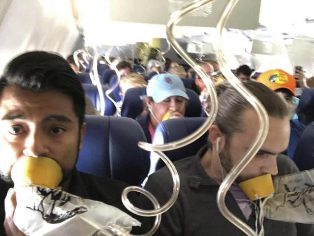 <p>In this April 17, 2018 photo provided by Marty Martinez, Martinez, left, appears with other passengers after a jet engine blew out on the Southwest Airlines Boeing 737 plane he was flying in from New York to Dallas, resulting in the death of a woman who was nearly sucked from a window during the flight with 149 people aboard. (Photo: Marty Martinez via AP) </p>
