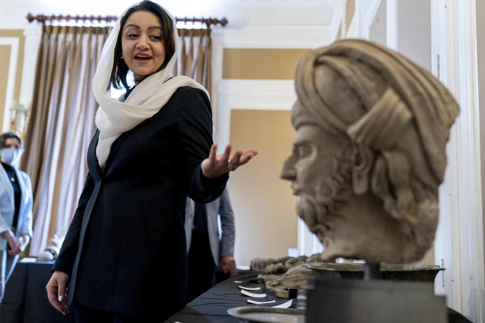 Afghan Ambassador to the U.S. Roya Rahmani, accompanied by embassy staff, speaks as she gives the Associated Press a tour at the Afghanistan Embassy in Washington, Wednesday, April 21, 2021, of looted and stolen Afghan religious relics and antiquities recovered by U.S. government authorities as part of a wider investigation into global trafficking in rare and ancient artifacts. (AP Photo/Andrew Harnik)
