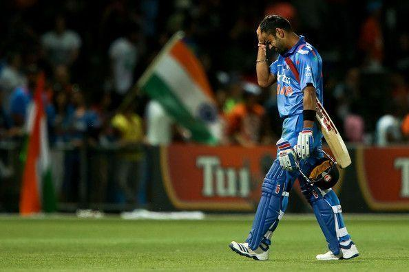 Kohli walks back after scoring a century against New Zealand in 2014