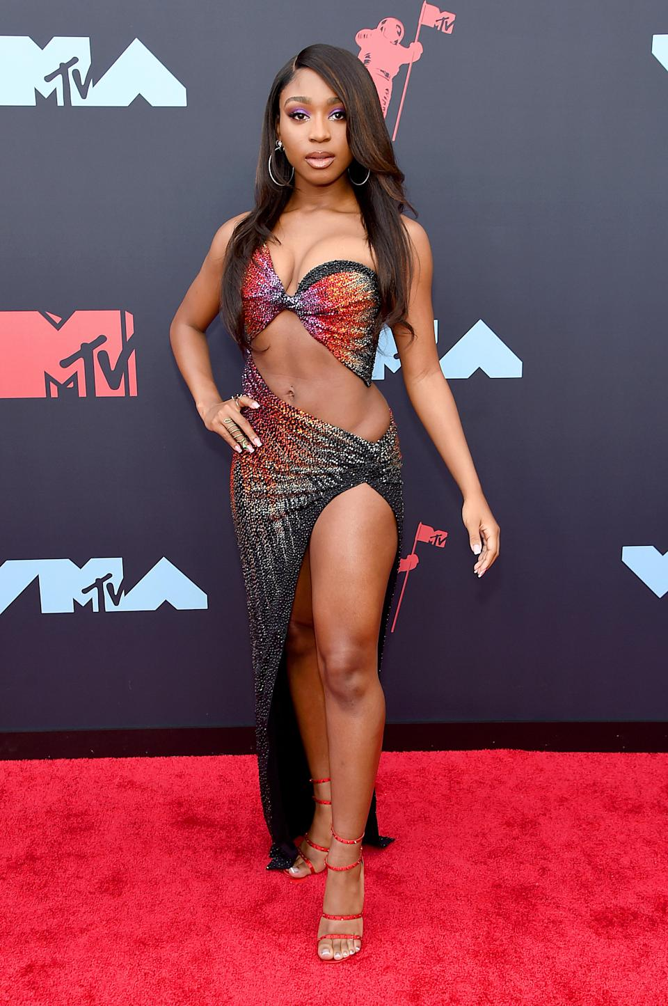 This look from Normani is so good we have to just use a full-body shot. The eye makeup matching the hues on her dress is perfection.