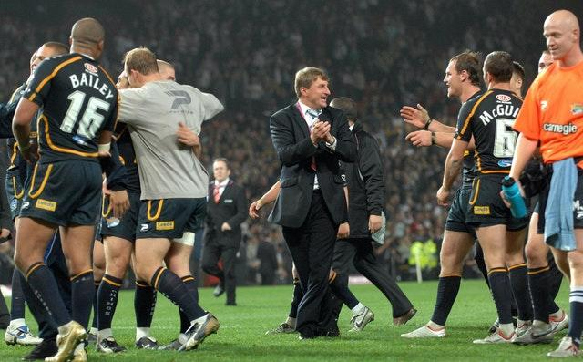 Tony Smith, centre, celebrated success following his final match as Leeds head coach