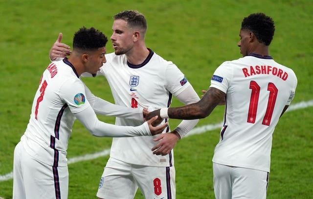 England's Jadon Sancho, left, and Marcus Rashford, right, suffered racist abuse after missing penalties