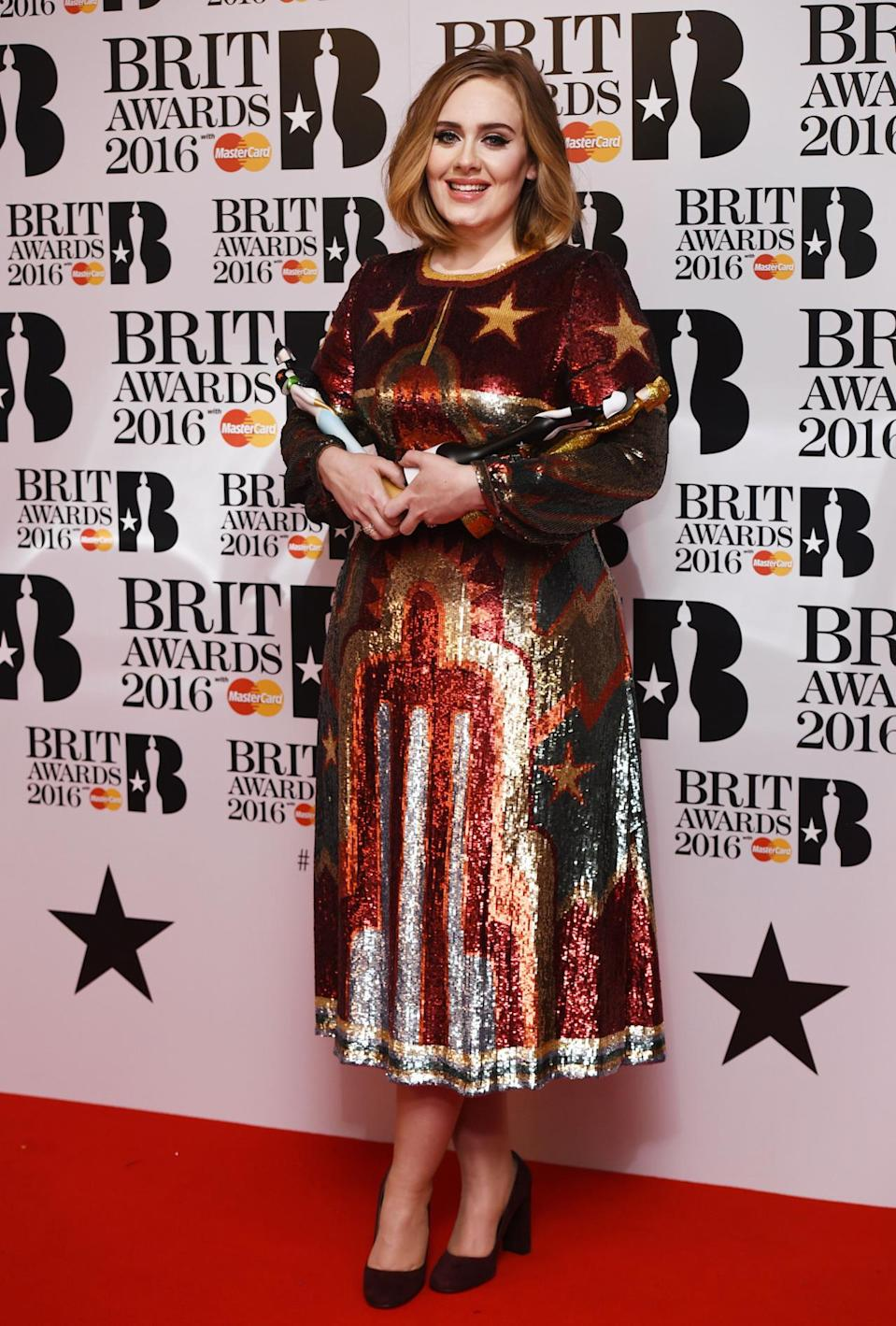 <p>The singer, who bagged four Brit Awards in total, changed into this dreamy sequin-covered number for her performance. <i>[Photo: Rex]</i></p>