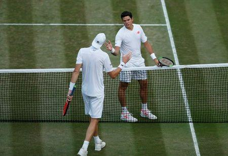 Tennis - Wimbledon - All England Lawn Tennis and Croquet Club, London, Britain - July 11, 2018 John Isner of the U.S. shakes hands with Canada's Milos Raonic after winning their quarter final match REUTERS/Andrew Boyers
