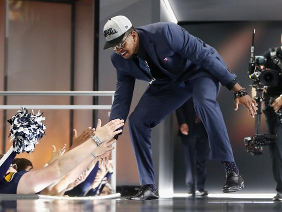Marcus Davenport of University of Texas San Antonio high fives fans after being picked number 14 overall by the New Orleans Saints during the first round of the 2018 NFL Draft (Getty)