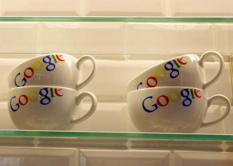 """FILE - In this Dec. 6, 2011 file photo, cups bearing the Google logo are displayed at Google France offices before its inauguration, in Paris. Publishers in France, Germany and Italy want their governments to impose a """"news tax"""" on Google to save them from extinction, demanding a law that would charge the search engine small payments in exchange for links to stories. Google, in response, says it will cease to index the sites altogether, warning that the proposals do nothing to solve the industry's problems on the continent that invented the printing press. (AP Photo/Jacques Brinon, Pool, File)"""