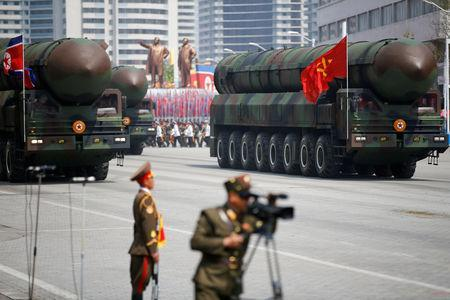 FILE PHOTO: Intercontinental ballistic missiles (ICBM) are driven past the stand with North Korean leader Kim Jong Un and other high ranking officials during a military parade marking the 105th birth anniversary of country's founding father Kim Il Sung, in Pyongyang April 15, 2017. REUTERS/Damir Sagolj/File Photo