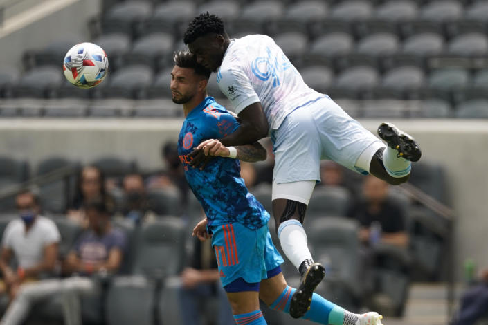 New York City FC midfielder Valentin Castellanos (11) and Los Angeles FC defender Jesus Murillo (94) head the ball during the first half of an MLS soccer game Saturday, May 29, 2021, in Los Angeles. (AP Photo/Ashley Landis)