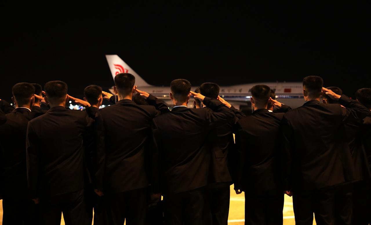 <p>North Koreans salute as an Air China jumbo jet carries leader Kim Jong-un shakes from Changi Airport on June 12, 2018, in Singapore. (Photo: Ministry of Communications and Information Singapore via Getty Images) </p>