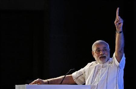 Gujarat's Chief Minister Modi speaks during the annual session of FICCI Ladies Organisation in New Delhi