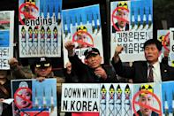 South Korean conservative activists in Seoul denounce North Korea's missile test-launch on March 26, 2014