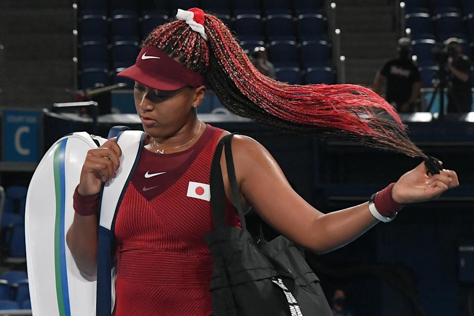 Japan's Naomi Osaka leaves the court after being beaten by Czech Republic's Marketa Vondrousova in their Tokyo 2020 Olympic Games women's singles third round tennis match at the Ariake Tennis Park in Tokyo on July 27, 2021. (Photo by Tiziana FABI / AFP) (Photo by TIZIANA FABI/AFP via Getty Images)