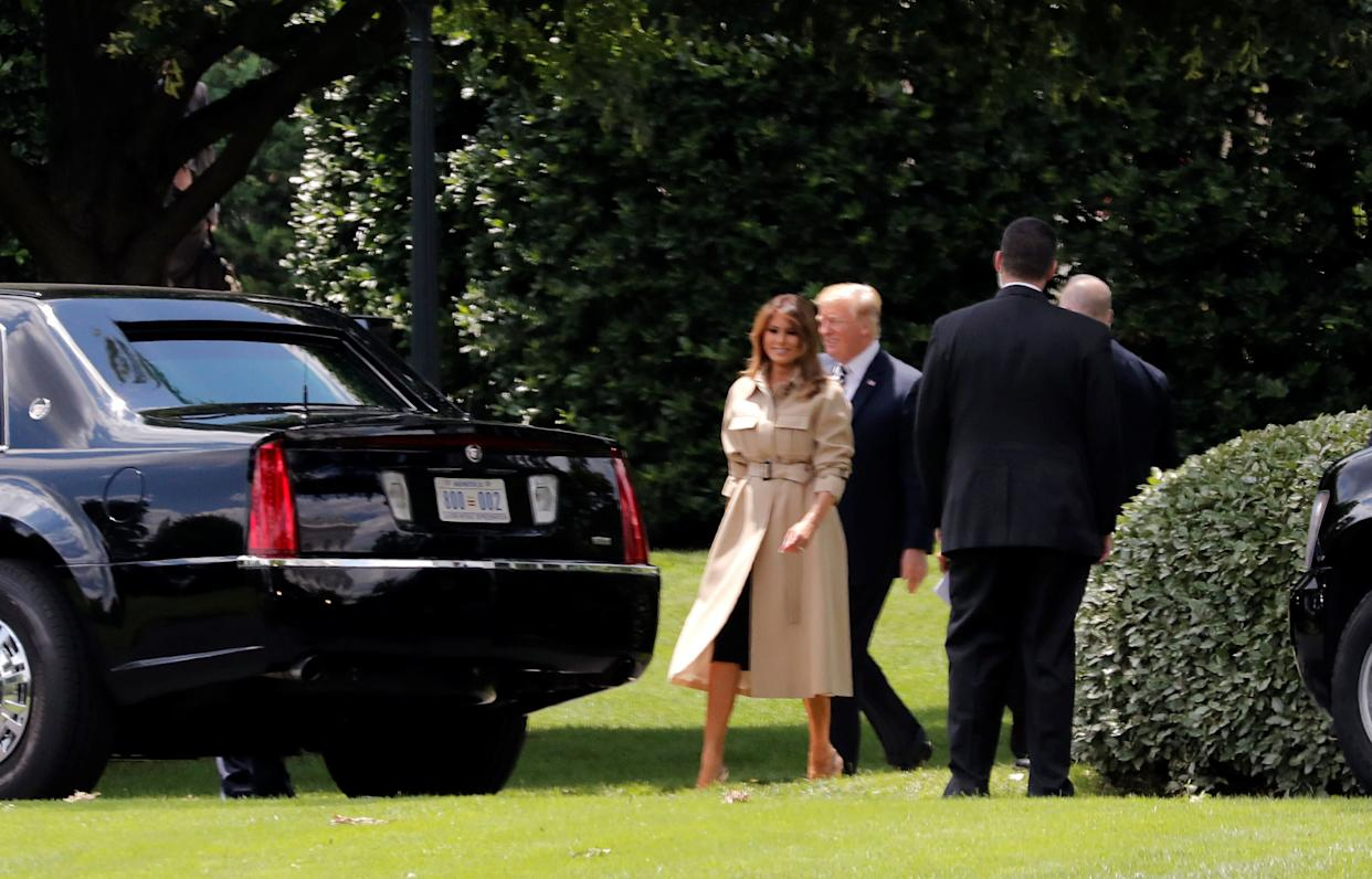 U.S. first lady Melania Trump heads to the presidential limo with President Donald Trump.