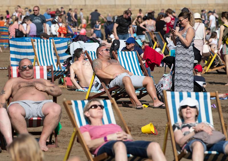 People enjoy the hot weather on Scarborough beach as Britain is set for a sunny Easter bank holiday weekend, that could break national records.