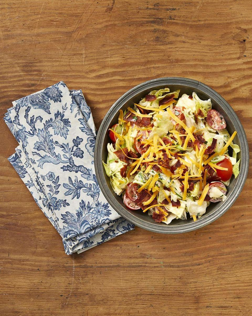 """<p>This flavorful salad is loaded with decadence—from the creamy buttermilk dressing, to the crispy bacon, to cheddar cheese. Serve alongside a bowl of soup for a complete meal.</p><p><a href=""""https://www.thepioneerwoman.com/food-cooking/recipes/a32905829/ranch-chopped-salad-recipe/"""" rel=""""nofollow noopener"""" target=""""_blank"""" data-ylk=""""slk:Get Ree's recipe."""" class=""""link rapid-noclick-resp""""><strong>Get Ree's recipe. </strong></a></p><p><a class=""""link rapid-noclick-resp"""" href=""""https://go.redirectingat.com?id=74968X1596630&url=https%3A%2F%2Fwww.walmart.com%2Fsearch%2F%3Fquery%3Dpioneer%2Bwoman%2Bsalad%2Bbowls&sref=https%3A%2F%2Fwww.thepioneerwoman.com%2Ffood-cooking%2Fmeals-menus%2Fg36806222%2Ffall-salad-recipes%2F"""" rel=""""nofollow noopener"""" target=""""_blank"""" data-ylk=""""slk:SHOP SALAD BOWLS"""">SHOP SALAD BOWLS</a></p>"""