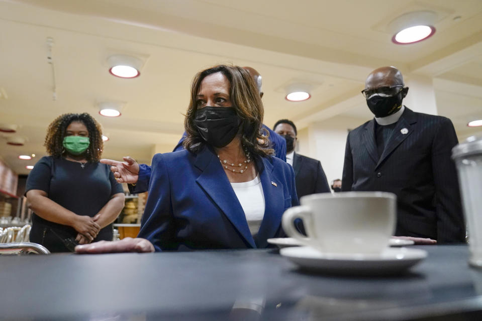 Vice President Kamala Harris sits at the lunch counter as she visits the International Civil Rights Center and Museum, Monday, April 19, 2021, in Greensboro, N.C. With Harris are LaTonya Wiley, museum tour guide, left, Melvin Skip Alston-Guilford County Board of Commissioners, John Swain, Museum director and Rev. Anthony Spearman, right.(AP Photo/Carolyn Kaster)