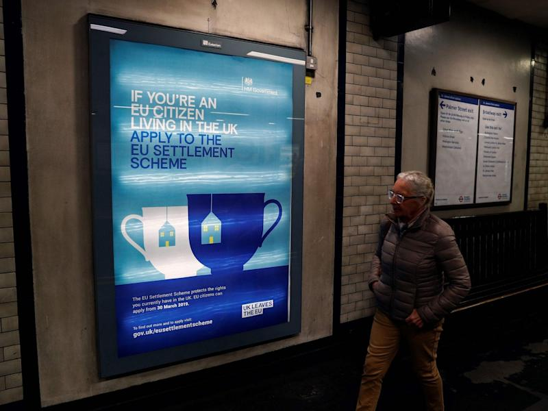 Government posters encouraging EU nationals to apply to the settlement scheme are a common sight in London Tube stations: AFP
