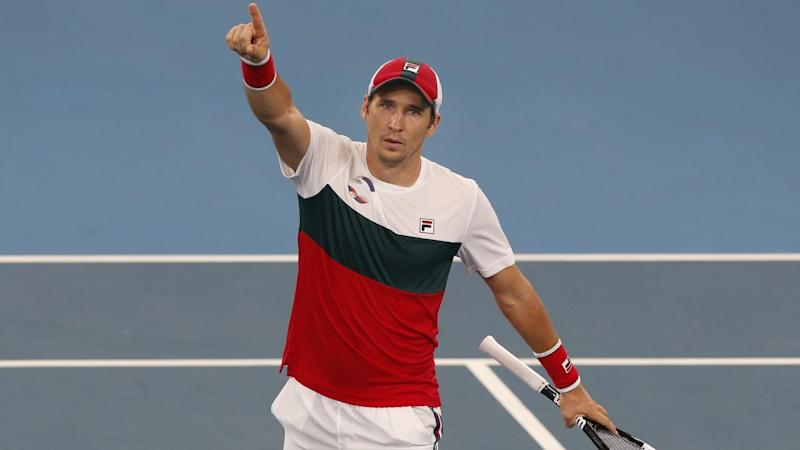 Dusan Lajovic of Serbia celebrates after defeating Karen Khachanov of Russia in the ATP Cup