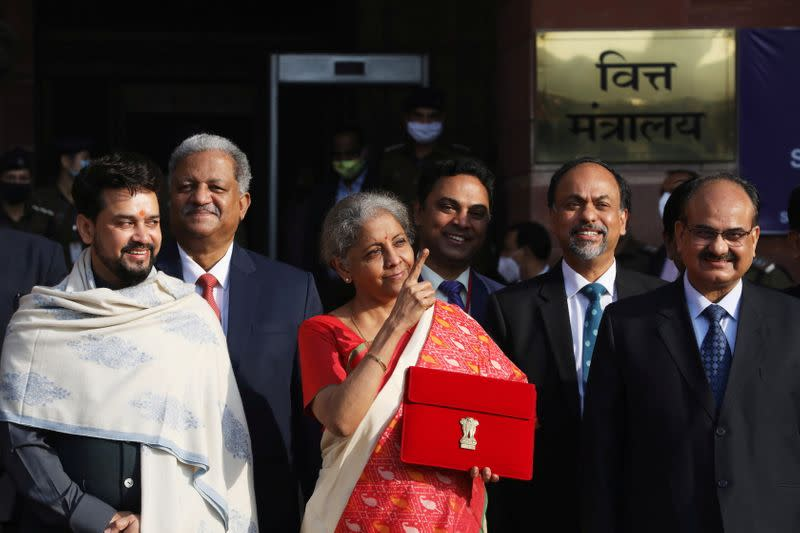 India's Finance Minister Nirmala Sitharaman stands next to Minister of State for Finance and Corporate Affairs Anurag Thakur as she leaves her office to present the federal budget in the parliament in New Delhi